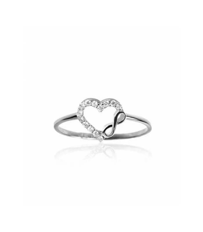c5acb0f9774e Anillo corazón de circonitas e infinito de oro blanco 18k.